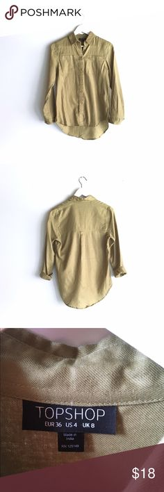 🆕 Topshop green button-up shirt New to the closet! Topshop army green button-up shirt, in lovingly worn condition. Subtle high-low effect, thin fabric, unique green hue -- so hard to capture, but the last photo shows truest color. Fits size 4. Topshop Tops Button Down Shirts
