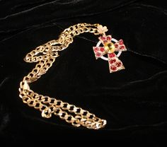 Contemporary men's jeweled cross and chain by LABBÉE HOMME JOAILLIER