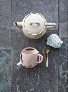 The spoon is perfect, the tea pot, and the cup. everything about this photo is perfect.