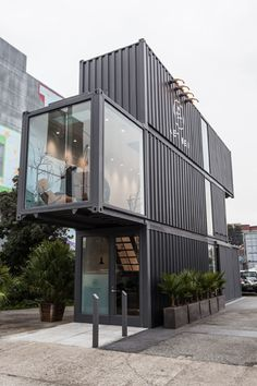 Aether, San Francisco  A trio of carbon-colored shipping containers lay stacked on top one another to form a retail store