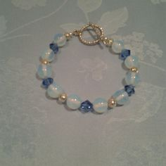 Opalite and Swarovski crystal bracelet New, never worn, handmade Opalite and Swarovski crystal beaded bracelet.  It is 7 3/4 inches long. Jewelry Bracelets
