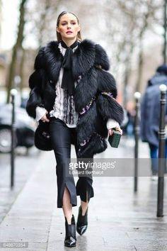 Olivia Palermo wears a black fur coat outside the Giambattista Valli show during Paris Fashion Week Womenswear Fall/Winter 2017/2018 on March 6 2017...
