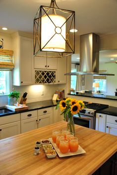 I love the pendant lamp...It looks like one of the possible choices for my kitchen-And it looks like a fun DIY.
