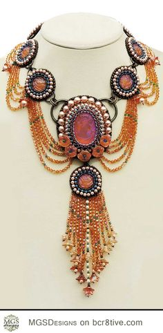 Exceptional Bead Artistry by Melissa Grakowsky Shippee? I like the use of o-rings as joining components!