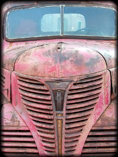 Grille (c) Seth Apter, old truck worn to pink hue