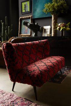 abigail ahern wild bill sofa, sculpture, faux plants, rugs, dark walls - yes please