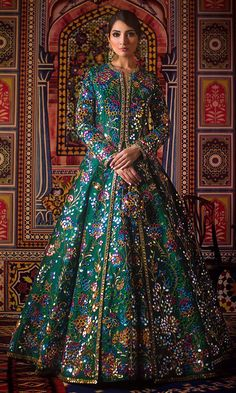 As timeless as this particular shade of green, this mirror-worked raw silk jacket and matching lehnga feature accents of blue, pink and burnt orange that make this whole look even grander. Pakistani Frocks, Pakistani Mehndi Dress, Pakistani Wedding Dresses, Pakistani Dress Design, Indian Wedding Outfits, Pakistani Outfits, Bridal Outfits, Indian Outfits, Dulhan Dress