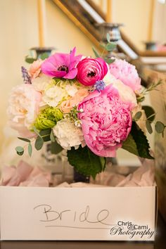 peony, hydrangea, mum, ranunculus, and anemone made up this beautiful wedding bouquet by Reynolds Treasures