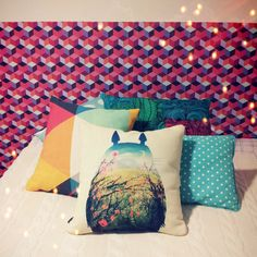 Colorful #pillows pop against a textured headboard! #bed #decor