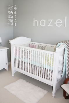 gray nursery with plain white letters
