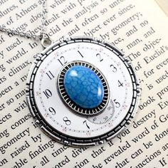 THE NEW FACE OF DRAGON VEIN CABPWF114  $27.00  Blue dragon veinnecklace with an antique white enamel pocket watch face.