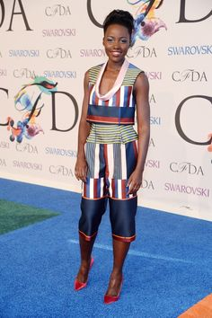 Lupita Nyong'o in custom Suno top and pants, Jennifer Fisher jewelry, and Sophia Webster Coco pumps at the #CFDA Awards // #CFDAAWARDS #redcarpet