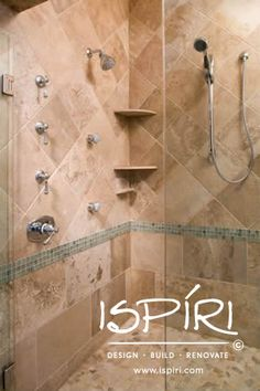 Shower body sprays, hand wand, corner shelves all accented with custom travertine tile