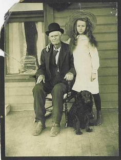 a girl, her grandfather and their dog, 1900