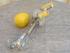 Retro Swift Whip brand ~ A Propert Product hand beater / mixer  Stainless steel with yellow painted timber handles  Made in Australia - sturdy and