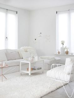 Ikea 'PS 2012' coffee table in very white living room