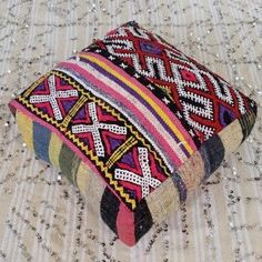 Colorful vintage Berber kilim Moroccan rugs and textiles have been artfully up-cycled to make this beautiful one of a kind floor cushion. Easily stuffed with cotton batting, foam or my favorite DIY method is to use several down/feather standard pillows. #pillows #globalstyle #globaltextile #bohemian #Morocco