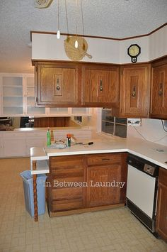 Click here for Part 2 of the Kitchen Cabinets Makeover ********** The kitchen cabinets in our new-to-us house used to look like this... ...