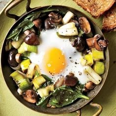 Eggs Baked Over Sauteed Mushrooms and Spinach - from Food & Wine, fun brunch recipe Spinach Recipes, Egg Recipes, Brunch Recipes, Wine Recipes, Vegetarian Recipes, Breakfast Recipes, Cooking Recipes, Healthy Recipes, Cooking Eggs