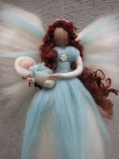 Miriam- Guardian angel This angel is handmade by using the needle felt technique. It is made of soft, high quality merino wool in magical colours. Size: approx. 23 cm All my fairies and angels are handmade with care on lovely details and will bring a little bit of magic to your home.