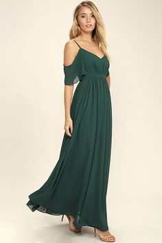 If you fancy a twirl in something spectacular, slip into the Ways of Desire Dark Green Maxi Dress! Woven poly forms a lightly pleated triangle bodice supported by spaghetti straps and fluttering sleeves. A banded waist gives way to a cascading maxi skirt. Hidden back zipper/clasp.