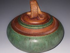 Moss/earthen-colored urn