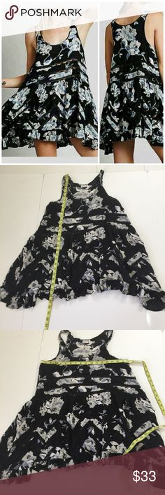 Free People Floral Twilight Trapeze Slip Dress, S Free People Floral Twilight Trapeze Slip Dress in size Small. Features a black floral pattern with cream, gray and blue with black lace. Flat lay measure at its shortest point is approximately 29, and from armpit to armpit is approximately 17. Made from  100% rayon and Lace is 100% nylon. In overall good used condition, please look at all photos and ask if you have any questions. Free People Dresses