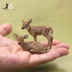 Dollhouse Miniature 1:12 fawn sculptures of BeeSputty clay, wire, paint & alpaca fiber & flock.