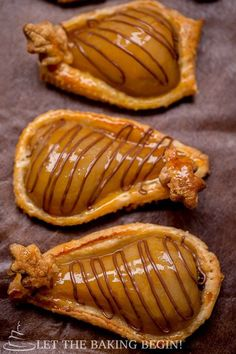 These wonderful puff pastries topped with pears poached in vanilla, rum and lemon zest syrup and finally stuffed with Nutella are baked to golden perfection. Mini Desserts, Puff Pastry Desserts, Puff Pastry Recipes, Just Desserts, Delicious Desserts, Individual Desserts, Plated Desserts, Pear Recipes, Fruit Recipes