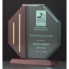 """Our Rosewood Octagon Acrylic Award features a clear acrylic area for engraving with rosewood and gold accents.  A6580 is 7.5"""" tall, A6581 is 8.5"""" tall, and A6582 is 9.5"""" tall.  Includes free personalized engraving."""