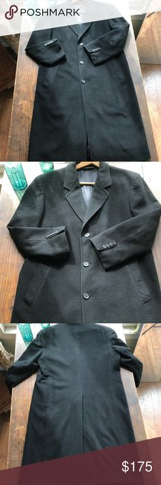 Brooks Brothers Black Overcoat **please read** In VERY good vintage condition, there are a few tiny flaws. See last photo. One is at rear collar and one on back. Fully lined with passport/travel ticket pockets and no rips, tears, stains or holes. No size or material tag. I'm nearly certain it's Merino Wool, but can't be 100% w/o tag. Refer to measurements for best fit. A classic wardrobe piece for the well-dressed gentleman. Brooks Brothers Jackets & Coats