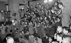 Forty-five cameramen photograph the new Japanese cabinet at the Prime Minister's official residence in downtown Tokyo on December 17, 1954. Japanese newspapers made a practice of assigning three or four photographers to cover an event from all possible angles. (AP Photo)