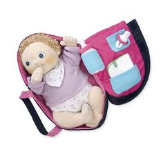 Rubens Barn; Four-in-One Carrycot Doll Carrier. I think she likes the carrier more than anything.