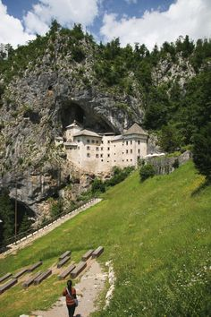 Explore Predjama Castle in Slovenia. Only an hour from Ljubljana, this castle built into the mouth of a cave is a must see! #slovenia #predjama #castle