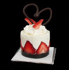 Lovely strawberry dessert with heart-shaped chocolate.