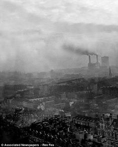The Great Smog of London of 1952 - Is this how the smog was created? This Daily Mail photograph taken from the top of Westminster Cathedral shows smoke pouring from chimneys and settling into the fog that 'caught' it and held it above the capital