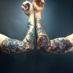 A beautiful photo of 2 beautiful sleeves with a collection of Kirk Jones tattoos.