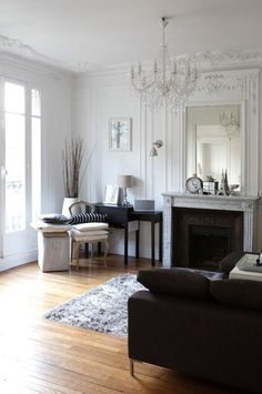 How To Decorate Like a Parisian - Hang a chandelier. It may be a bit of a cliché, but hanging a chandelier above the dining table or in the living room is the simplest way to introduce a bit of Parisian style into your home — think the Palace of Versailles. And you don't have to spend lots of money: you can find some reasonable options at IKEA or on Ebay.