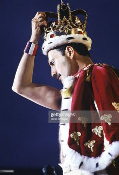 Singer Freddie Mercury (1946 - 1991) wearing a crown during a performance with British rock group Queen , 1986.