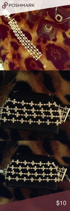 """CROSS BRACELET COSTUME JEWLERY This bracelet has four individual strands of rhinestone crosses.  Perfect as a gift for your friend from Bible study, or for a religion teacher. Length of bracelet is 8"""" exactly! claires Jewelry Bracelets"""