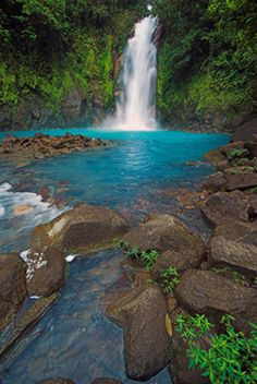 """The blue lagoon - Rio Celeste waterfall in Costa Rica. After seeing the Muddy Mississippi here everyday, it would be a nice change of scenery to visit a waterfall with """"fresh"""" water. It amazes me the places where you can actually see the bottom of where you are swimming. The scenery captured in this picture is stunning. #Motel6UBL"""