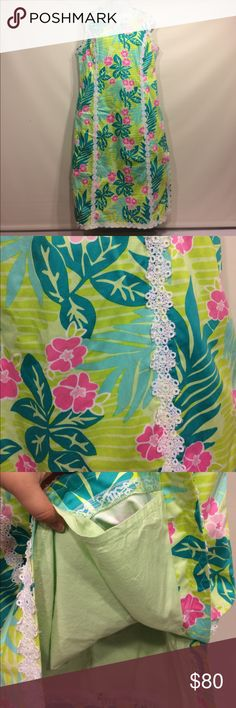 Lilly Pulitzer Floral/Leaves Dress Lilly Pulitzer green dress with pink flowers & leaves. White lace trim. Size 14. Zipper in back. Great condition. Lilly Pulitzer Dresses Midi