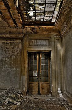 -the beauty still peeks through the fallen rubble. Abandoned Buildings, Abandoned Property, Abandoned Mansions, Old Buildings, Abandoned Places, Beautiful Ruins, Beautiful Places, Urban Decay, Old Doors