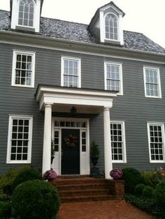 Blue houses with gray or black shutters care to guess those paint colors for the home - Kinds siding consider home ...