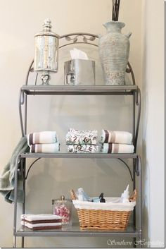 Bakers rack in the bathroom. We are going to paint this bakers rack a champagne color eventually...