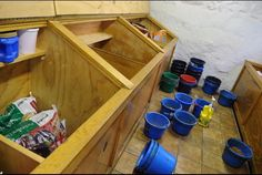 LOVE these feed storage spaces. Would want sliding lids for these bins.
