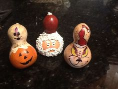 Small gourds....Jack O'Lantern with ghost, Santa, and my favorite ,The Grinch