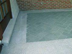 A combination of Kota Stone and honed basalt stone flooring
