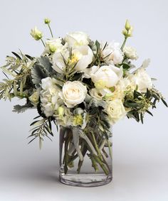 Radiant Whites A lovely collection of blooms in shades of whites and creams - including peonies, roses, and hydrangea - with unique, textural accents is designed in our signature cylinder vase