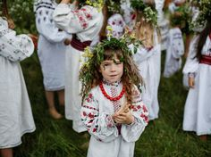 A girl attends a celebration on the traditional Ivana Kupala (Ivan the Bather) holiday, the ancient tradition, originating from pagan times, is usually marked with grand overnight festivities during which people sing and dance around campfires, believing it will purge them of their sins and make them healthier, in Kiev, Ukraine, July 6, 2016. (Photo by Gleb Garanich/Reuters)